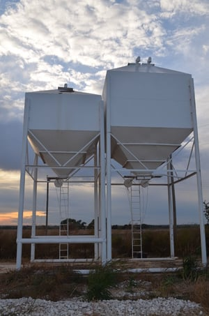 overhead bins for feed, fertilizer and other granular products  increase  your efficiency! no more feed sacks or rodents contaminating your feed!
